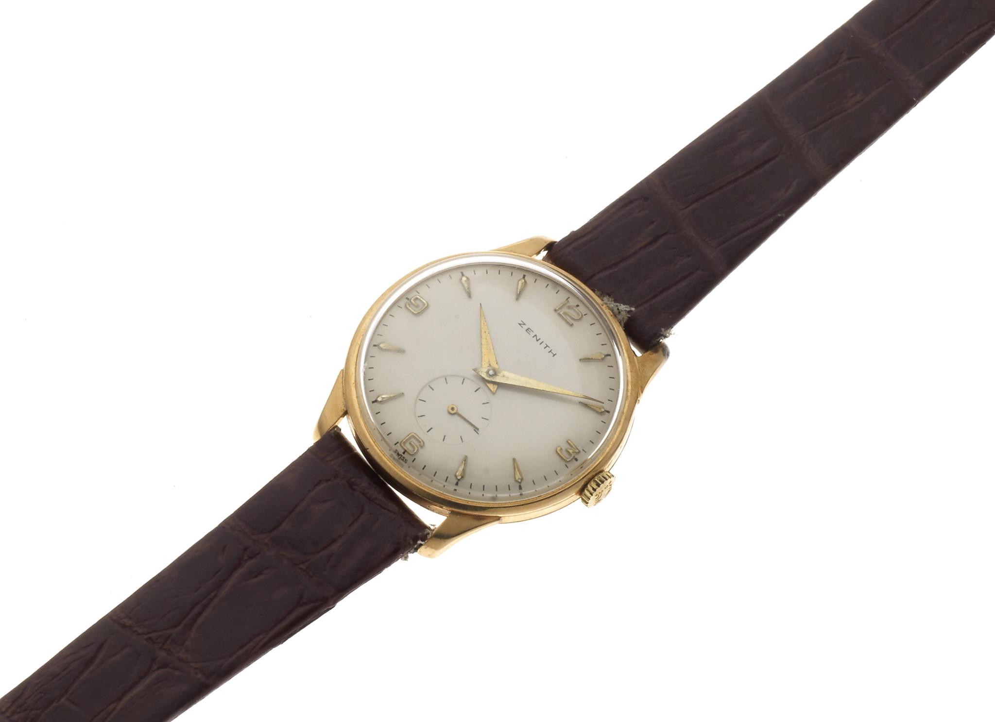 Zenith. An 18K gold manual wind wristwatch