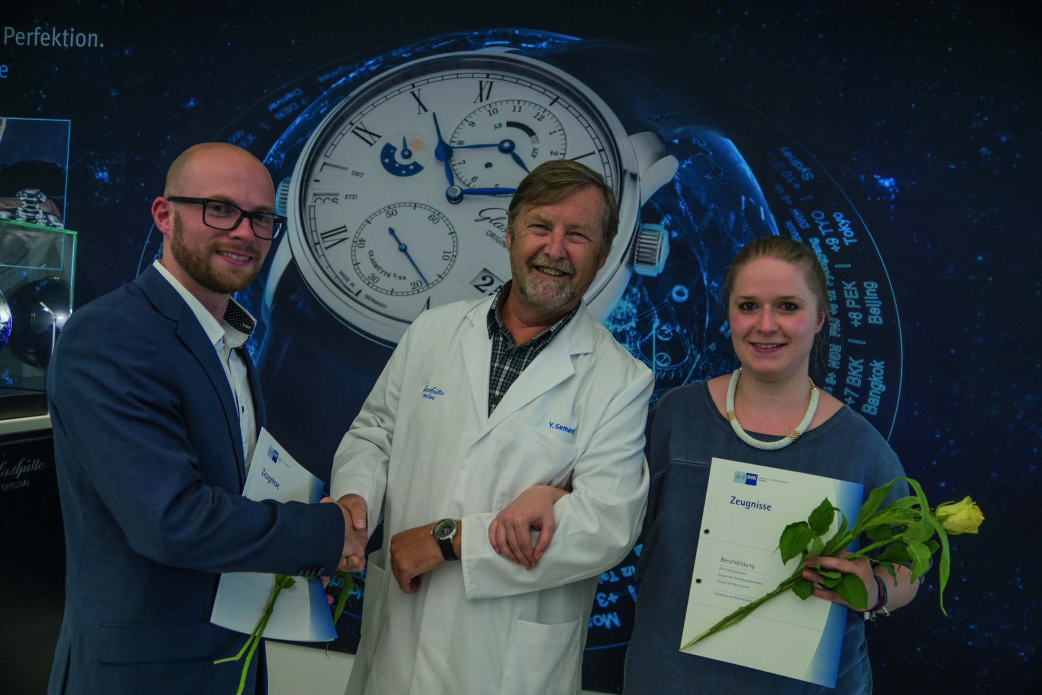Glashütte Original CEO Yann Gamard with the two best graduates of 2016_Birgit Schönfeldt and Robert Löwe