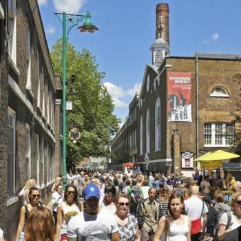 bigstock-Tourists-In-Brick-Lane-On-A-Bu-66470386